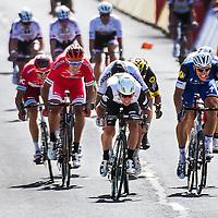 Frankrijk, Utah Beach, 02-07-2016<br /> Wielrennen, Tour de France, 1e etappe.<br /> Van Mont-Saint-Michel naar Utah Beach.<br /> Mark Cavendish wint de sprint van de eerste tour etappe voor Marcel Kittel ( blauw ), Peter Sagan ( achter zijn rug ) en Andre Greipel ( uiterst rechts )<br /> Foto: Klaas Jan van der Weij