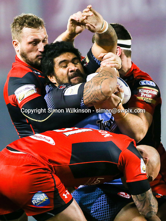 Picture by Alex Whitehead/SWpix.com - 12/02/2015 - Rugby League - First Utility Super League - Salford Red Devils v St Helens - AJ Bell Stadium, Salford, England - St Helens' Mose Masoe is tackled by Salford's Josh Griffin, Jordan Walne and Cory Paterson.