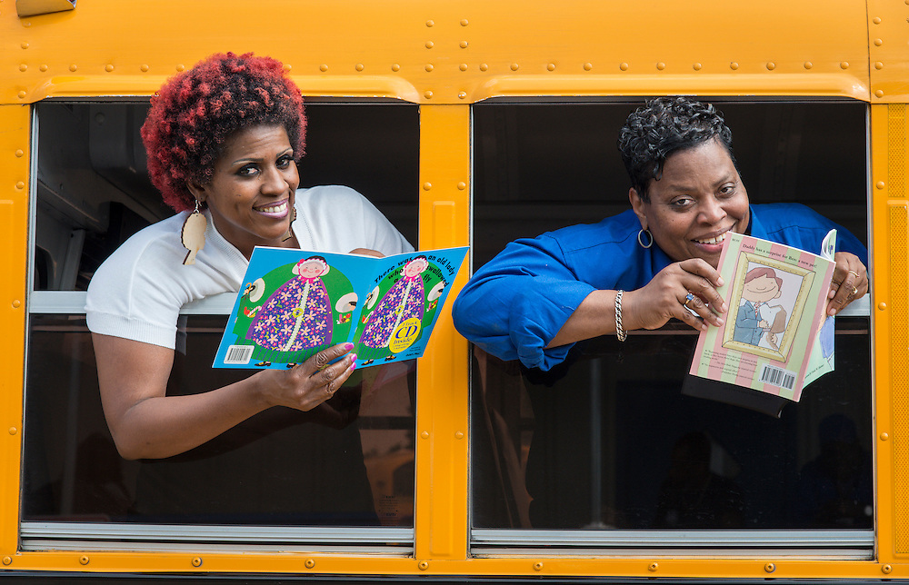 """Bus drivers pose for a photograph to promote the Houston ISD """"Reading and Riding"""" program, April 7, 2015."""