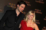 """PARIS, FRANCE - APRIL 28:  Robert Pattinson and Reese Witherspoon attend """"Water for Elephants' Premiere at Le Grand Rex Theater on April 28, 2011 in Paris, France.  (Photo by Tony Barson/FilmMagic)"""