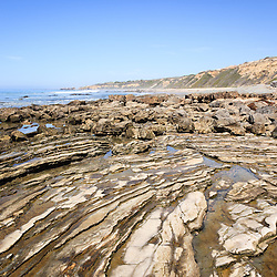 Photo of Crystal Cove tide pools and rock formations. Crystal Cove State Park is located along the Pacific Ocean in Laguna Beach and Newport Beach in Southern California.