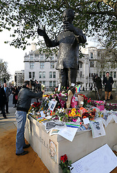 Mourners lay flowers at the statue of Nelson Mandela in Parliament Square, London,  Friday, 6th December 2013, following the death Nelson Mandela, Picture by Stephen Lock / i-Images