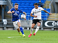 Football - 2019 / 2020 Championship - Play-off semi-final - 1st leg - Cardiff City vs Fulham<br /> <br /> Joe Ralls of Cardiff City & Anthony Knockaert of Fulham<br /> in a match played with no crowd due to Covid 19 coronavirus emergency regulations, in an almost empty ground, at the Cardiff City Stadium<br /> <br /> COLORSPORT/WINSTON BYNORTH