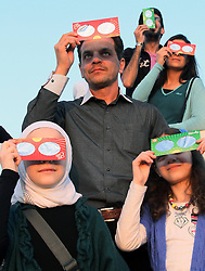 60670632  <br /> Syrians gather in a stadium in the capital Damascus on Nov. 3, 2013 to observe a partial solar eclipse that was witnessed in Syria and neighbouring Lebanon, Sunday November 3 2013. Picture by  imago / i-Images.<br /> UK ONLY