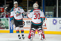 KELOWNA, CANADA - MARCH 8: Madison Bowey #4 and Jordon Cooke #30 of the Kelowna Rockets celebrate a goal against the Tri-City Americans on March 8, 2014 at Prospera Place in Kelowna, British Columbia, Canada.   (Photo by Marissa Baecker/Getty Images)  *** Local Caption *** Madison Bowey; Jordon Cooke;