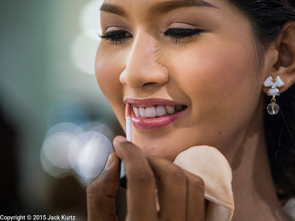 25 MARCH 2015 - BANGKOK, THAILAND: A contestant get her makeup touched up during the first round of the Miss Tiffany's contest at CentralWorld, a large shopping mall in Bangkok. Miss Tiffany's Universe is a beauty contest for transgender contestants; all of the contestants were born biologically male. The final round will be held on May 8 in the beach resort of Pattaya. The final round is televised of the  Miss Tiffany's Universe contest is broadcast live on Thai television with an average of 15 million viewers.     PHOTO BY JACK KURTZ