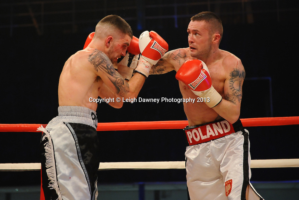 Mariusz Bak (whote shorts) defeats Ricky O'Brien in a Super Featherweight contest on 15th March 2014 at the Rivermead Leisure Centre, Reading, Berkshire. Promoted by Hennessy Sports. © Leigh Dawney Photography 2014.
