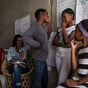 Two girls are role-playing to demonstrate how they should behave when approached by men who want to initiate sex, during a behavioral change communication workshop designed to prevent intimate partner violence and HIV-risk behaviours, in the township of Lamiontville in Durban. 09 November 2017. Lamontville, Durban, South Africa.  © Miora Rajaonary / Wall Street Journal