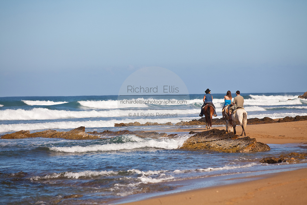 Horseback riders at Las Marias beach in Rincon Puerto Rico