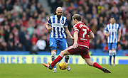 Brighton defender, Bruno Saltor (2) and Middlesbrough FC midfielder Grant Leadbitter during the Sky Bet Championship match between Brighton and Hove Albion and Middlesbrough at the American Express Community Stadium, Brighton and Hove, England on 19 December 2015.