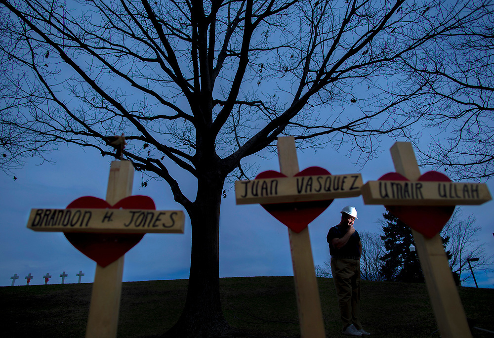 Greg Zanis at Northern Illinois University among some of the 129 crosses that he built as a vigil, each bearing the name of one of the murder victims in Chicago in 2017.