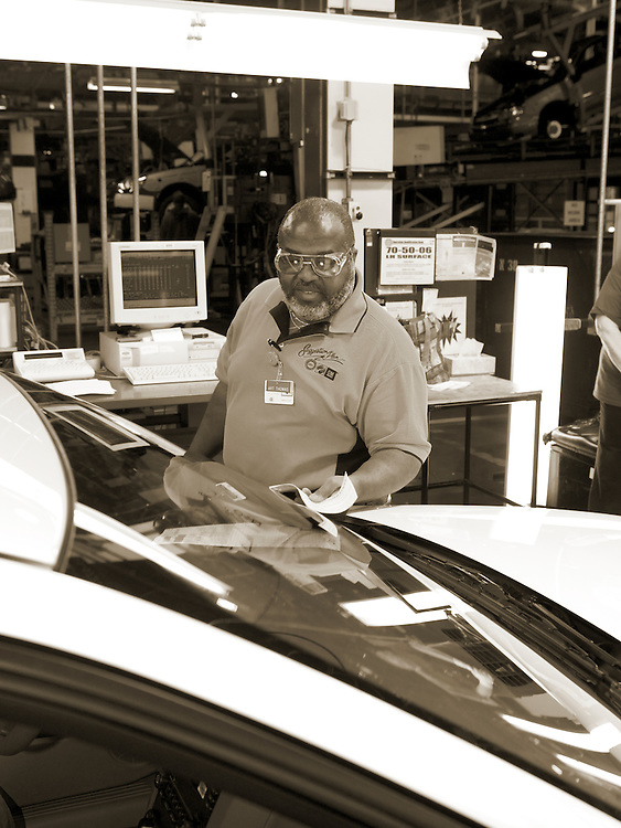 General Motors worker inspects a car at the factory in Fairfax, KS.