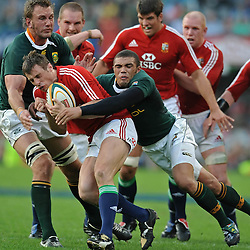 Tommy Bowe of the British and Irish Lions is tackled by Bryan Habana and Andries Bekker of the South Africa  during the British and Irish Lions tour 2009