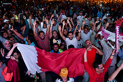 Fans of Qatar celebrate after their team's victory over Japan in the 2019 AFC Asian Cup final match between Japan and Qatar on giant screens at a street in the Qata?ri capital Doha on February 01, 2019.Qatar beat Japan 3-1 in UAE to win the AFC for the first time  (Credit Image: © Nikku/Xinhua via ZUMA Wire)