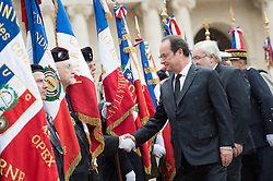 French President Francois Hollande greets veterans during a national tribute to Harkis - Muslim Algerians who served as Auxiliaries in the French Army during the Algerian War from 1954 to 1962 - at Hotel des Invalides in Paris, France on September 25, 2016. Photo by Chamussy/Pool/ABACARESS.COM