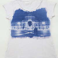 Exquisite blue over white handmade t-shirt with an image of Lisbon's iconic square, Pra&ccedil;a do Com&eacute;rcio.<br />