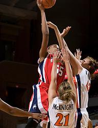 Richmond forward/center Crystal Goring (55) shoots over Virginia guard Tara McKnight (21) and Virginia forward Kelly Hartig (42).  The Virginia Cavaliers women's basketball team faced the Richmond Spiders at the John Paul Jones Arena in Charlottesville, VA on November 18, 2007.