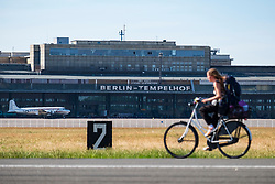 Cyclist on runway at former Tempelhof Airport now public park  in Kreuzberg, Berlin, Germany