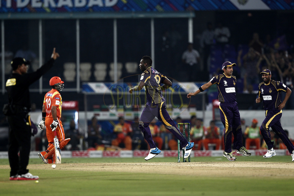 Gautam Gambhir captain of the Kolkata Knight Riders , Andre Russell of the Kolkata Knight Riders celebrates the wicket of  Nasir Jamshed of the LAHORE LIONS during match 7 of the Oppo Champions League Twenty20 between the Kolkata Knight Riders and the Lahore Lions held at the Rajiv Gandhi Cricket Stadium, Hyderabad, India on the 21st September 2014<br /> <br /> Photo by:  Deepak Malik / Sportzpics/ CLT20<br /> <br /> <br /> Image use is subject to the terms and conditions as laid out by the BCCI/ CLT20.  The terms and conditions can be downloaded here:<br /> <br /> http://sportzpics.photoshelter.com/gallery/CLT20-Image-Terms-and-Conditions-2014/G0000IfNJn535VPU/C0000QhhKadWcjYs