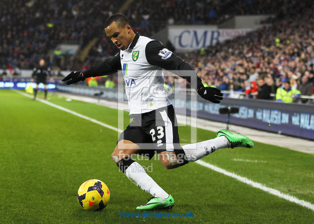 Picture by Tom Smith/Focus Images Ltd 07545141164<br /> 01/02/2014<br /> Martin Olsson of Norwich City crosses the ball into the box during the Barclays Premier League match at the Cardiff City Stadium, Cardiff.