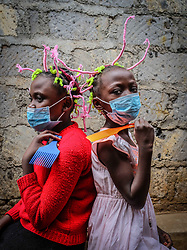 May 9, 2020, Nairobi, Kenya: 12 year old, Martha Apisa (left) and her close neighbour, 8 year old Stacy Ayuma (Right) are seen using their hair style braids to create awareness and sensation about the Corona Virus during the pandemic..Kenya has recorded 649 confirmed cases, 207 recovered and 30 deaths to the covid 19 disease. (Credit Image: © Donwilson Odhiambo/SOPA Images via ZUMA Wire)