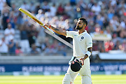 Wicket - Virat Kohli (captain) of India waves to the fans with his bat as he walks back to the pavilion after being dismissed by Adil Rashid of England during second day of the Specsavers International Test Match 2018 match between England and India at Edgbaston, Birmingham, United Kingdom on 2 August 2018. Picture by Graham Hunt.