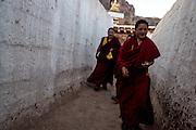 Buddhist monks walk through the streets of the Rabgya monestary in Golok region, Tibet (Qinghai, China). The monestary is home to around 500 monks of the Gelukpa sect.