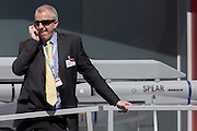 Delegate makes a call alongside a Spear missile of defence manufacturer MBDA at the Farnborough Air Show, England. MBDA, a world leader in missiles and missile systems, is a multi-national group with 10,000 employees working across France, the United Kingdom, Italy, Germany, Spain and the United States.