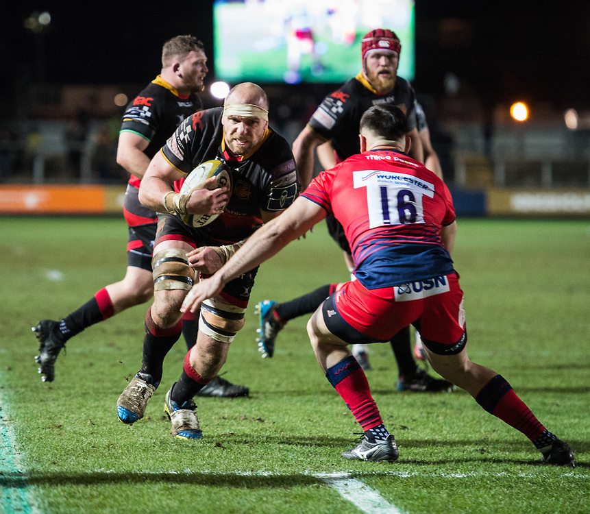 Dragons' Rynard Landman charges towards the try line but Worcester Warriors' Matt Williams stands in his way.<br /> <br /> Photographer Simon Latham/Replay Images<br /> <br /> Anglo-Welsh Cup Round Round 4 - Dragons v Worcester Warriors - Friday 2nd February 2018 - Rodney Parade - Newport<br /> <br /> World Copyright © Replay Images . All rights reserved. info@replayimages.co.uk - http://replayimages.co.uk