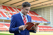 Nottingham Forest midfielder Matty Cash (41) reads the Forest Review match day program during the EFL Sky Bet Championship match between Nottingham Forest and Brighton and Hove Albion at the City Ground, Nottingham, England on 4 March 2017. Photo by Jon Hobley.