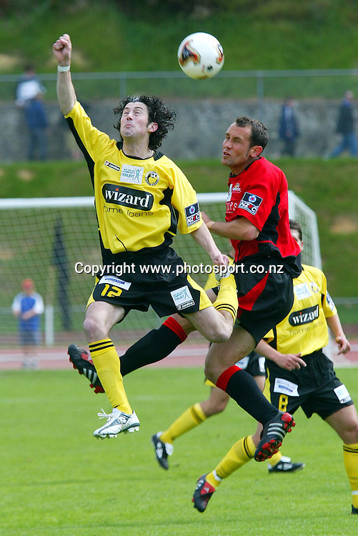 Wellington's Brian Little heads a ball out of reach of Canterbury's Justin Lucas during the 2 all draw on Newtown Park, Sunday afternoon. Soccer NZFC Round 1 17 October 2004.<br /> Photo: Marty Melville/Photosport