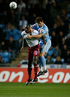 Photo: Steve Bond.<br /> Coventry City v West Ham United. Carling Cup. 30/10/2007.Carlton Cole (L) is beaten in the air by Arjan de Zeeuw (R)