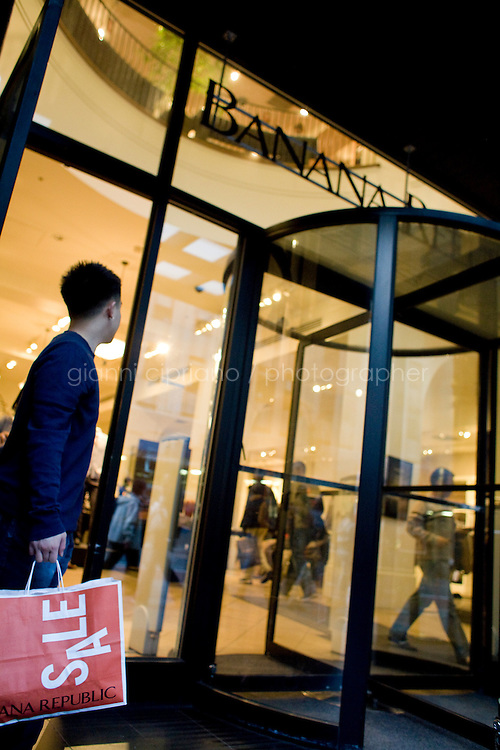 4 October, 2008. A customer exits the Banana Republic store of 34th street and 5th ave. As the financial crisis spread last month, many retailers hit the panic button, offering more generous discounts than they did at the same time last year. But the promotions did little to convince cautious shoppers to open their wallets.<br /> <br /> ©2008 Gianni Cipriano for The Wall Street Journal<br /> cell. +1 646 465 2168 (USA)<br /> cell. +1 328 567 7923 (Italy)<br /> gianni@giannicipriano.com<br /> www.giannicipriano.com