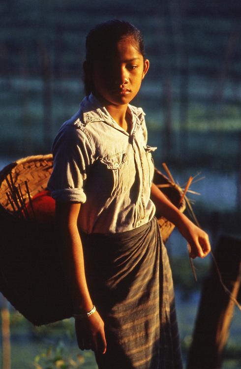 Portrait of Lao teen age girl carrying market basket