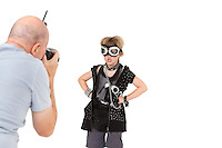 Senior adult photographer shooting punk kid over white background