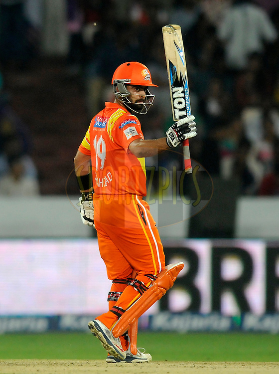 Ahmed Shehzad of Lahore Lions acknowledges his teammates after scoring a half century during match 7 of the Oppo Champions League Twenty20 between the Kolkata Knight Riders and the Lahore Lions held at the Rajiv Gandhi Cricket Stadium, Hyderabad, India on the 21st September 2014<br /> <br /> Photo by:  Pal Pillai / Sportzpics/ CLT20<br /> <br /> <br /> Image use is subject to the terms and conditions as laid out by the BCCI/ CLT20.  The terms and conditions can be downloaded here:<br /> <br /> http://sportzpics.photoshelter.com/gallery/CLT20-Image-Terms-and-Conditions-2014/G0000IfNJn535VPU/C0000QhhKadWcjYs