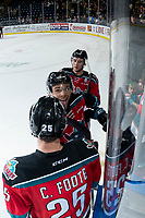 KELOWNA, CANADA - OCTOBER 27: Cal Foote #25 and Gordie Ballhorn #4 congratulate Carsen Twarynski #18 of the Kelowna Rockets as he exits the ice on the OT winning goal against the Tri-City Americans  on October 27, 2017 at Prospera Place in Kelowna, British Columbia, Canada.  (Photo by Marissa Baecker/Shoot the Breeze)  *** Local Caption ***