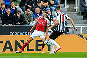 Hector Bellerin (#2) of Arsenal controls the ball under pressure from Paul Dummett (#3) of Newcastle United during the Premier League match between Newcastle United and Arsenal at St. James's Park, Newcastle, England on 15 September 2018.