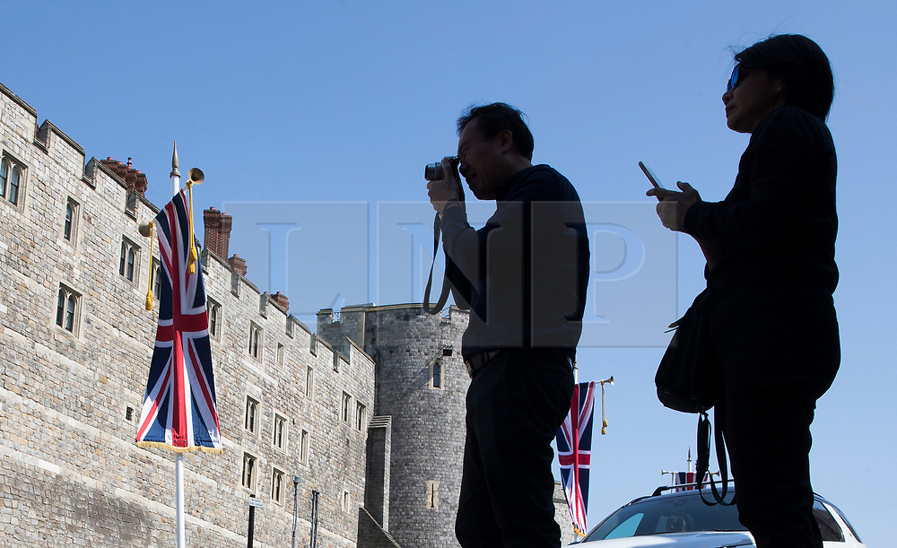 © Licensed to London News Pictures. 15/05/2018. Windsor, UK. Tourists take photographs of Windsor Castle ahead of the marriage of Prince Harry and Meghan Markle on Saturday. Photo credit: Peter Macdiarmid/LNP