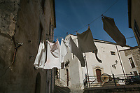 "SUTERA, ITALY - 8 JANUARY 2018: Line-drying clothes are seen here in ""Rabato"", a district of the historical center of Sutera, Italy, on January 8th 2018.<br /> <br /> Sutera is an ancient town plastered onto the side of an enormous monolithic rock, topped with a convent, in the middle of the western half of Sicily, about 90 minutes by car south of the Sicilian capital Palermo<br /> Its population fell from 5,000 in 1970 to 1,500 today. In the past 3 years its population has surged  after the local mayor agreed to take in some of the thousands of migrants that have made the dangerous journey from Africa to the Sicily.<br /> <br /> ""Sutera was disappearing,"" says mayor Giuseppe Grizzanti. ""Italians, bound for Germany or England, packed up and left their homes empty. The deaths of inhabitants greatly outnumbered births. Now, thanks to the refugees, we have a chance to revive the city.""<br />  Through an Italian state-funded project called SPRAR (Protection System for Refugees and Asylum Seekers), which in turn is co-funded by the European Union's Fund for the Integration of non-EU Immigrants, Sutera was given financial and resettlement assistance that was co-ordinated by a local non-profit organization called Girasoli (Sunflowers). Girasoli organizes everything from housing and medical care to Italian lessons and psychological counselling for the new settlers.<br /> The school appears to have been the biggest beneficiary of the refugees' arrival, which was kept open thanks to the migrants.<br /> Nunzio Vittarello, the coordinator of the E.U. project working for the NGO ""I Girasoli"" says that there are 50 families in Sutera at the moment."