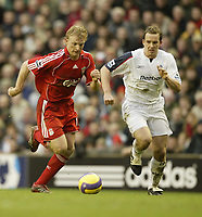 Photo: Aidan Ellis.<br /> Liverpool v Bolton Wanderers. The Barclays Premiership. 01/01/2007.<br /> Liverpool's Dirk Kuyt (L) is chased by Bolton's Kevin Davis