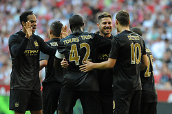31.07.2013, Allianz Arena, Muenchen, Audi Cup 2013, Manchester City vs AC Milan, im Bild, Torschuetze Edin DZEKO (Manchester City) rechts, wird von Javi GARCIA (Manchester City) beglueckwuenscht (2.v.r.), daneben Yaya TOURE (Manchester City) // during the Audi Cup 2013 match between Manchester City and AC Milan at the Allianz Arena, Munich, Germany on 2013/07/31. EXPA Pictures © 2013, PhotoCredit: EXPA/ Eibner/ Wolfgang Stuetzle<br /> <br /> ***** ATTENTION - OUT OF GER *****
