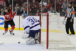 Feb 9; Newark, NJ, USA; Tampa Bay Lightning goalie Dwayne Roloson (30) makes a save on a shot from New Jersey Devils right wing David Clarkson (23) during the first period at the Prudential Center.