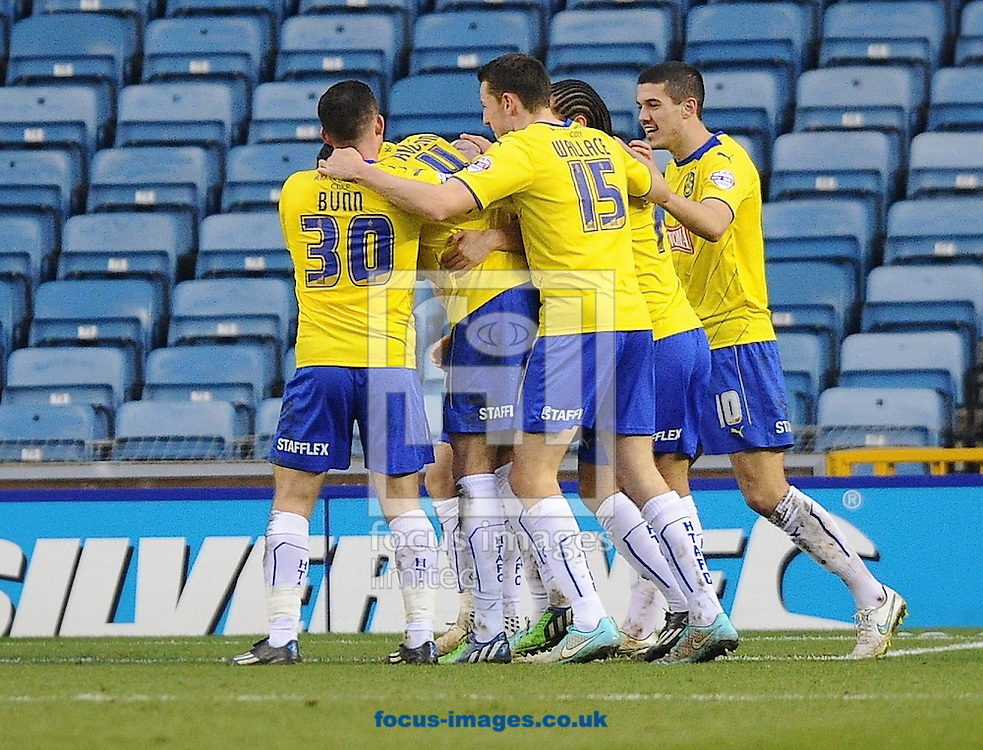 Players of Huddersfield Town celebrate after scoring to make it 1-2 during the Sky Bet Championship match at The Den, London<br /> Picture by Alan Stanford/Focus Images Ltd +44 7915 056117<br /> 07/02/2015