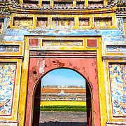 at the Imperial City in Hue, Vietnam. A self-enclosed and fortified palace, the complex includes the Purple Forbidden City, which was the inner sanctum of the imperial household, as well as temples, courtyards, gardens, and other buildings. Much of the Imperial City was damaged or destroyed during the Vietnam War. It is now designated as a UNESCO World Heritage site. This gate was an entrance to the Dien Tho Residence. Constructed in 1804, this compound was was the Queen Mother's or Emperor's Grandmother's living quarters.