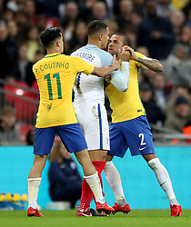 England's Jake Livermore (centre) has a confrontation with Brazil's Neymar (left) and Dani Alves during the Bobby Moore Fund International match at Wembley Stadium, London.