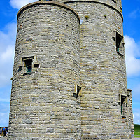 O'Brien's Tower at Cliffs of Moher near Liscannor, Ireland<br /> Sir Cornelius O'Brien built this round tower at the mid-point of the Cliffs of Moher in 1835. His goal was to attract tourists to the geological pride of County Clare.  Since it was restored and reopened in 1974, you can climb to the top for a small fee. The views of the cliffs and the crashing sea from the battlements are incredible.  On a clear day, you can see the Aran Islands and Galway Bay.