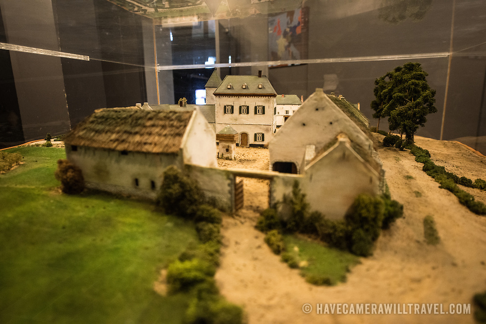 A model of the Chateau d'Hougoumont, a large farmhous that was bitterly contested during the Battle of Waterloo. The model is in the basement of the Panorama of the Battle of Waterloo, built in 1912 for the centenery celebrations of the battle and situated next to the Butte du Lion (Lion's Mound) on the former battleground. The painting on the wall is 100 metres long and 12 metres high, painted by Louis Dumoulin, and a team of military artists. It portrays the battlefield at about 6 p.m. on June 18, 1815.