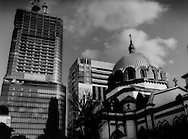 Tokyo's Russian Orthodox Holy Resurrection Cathedral competes with high rises for a piece of the Tokyo sky.  Ochanomizu, Tokyo, Japan.