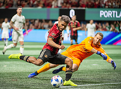 December 8, 2018 - Atlanta, Georgia, United States - Atlanta United forward JOSEF MARTINEZ (7) scores a goal past a diving Portland Timbers goalkeeper JEFF ATTINELLA (1) during the MLS Cup at Mercedes-Benz Stadium in Atlanta, Georgia.  Atlanta United defeats Portland Timbers 2-0 (Credit Image: © Mark Smith/ZUMA Wire)